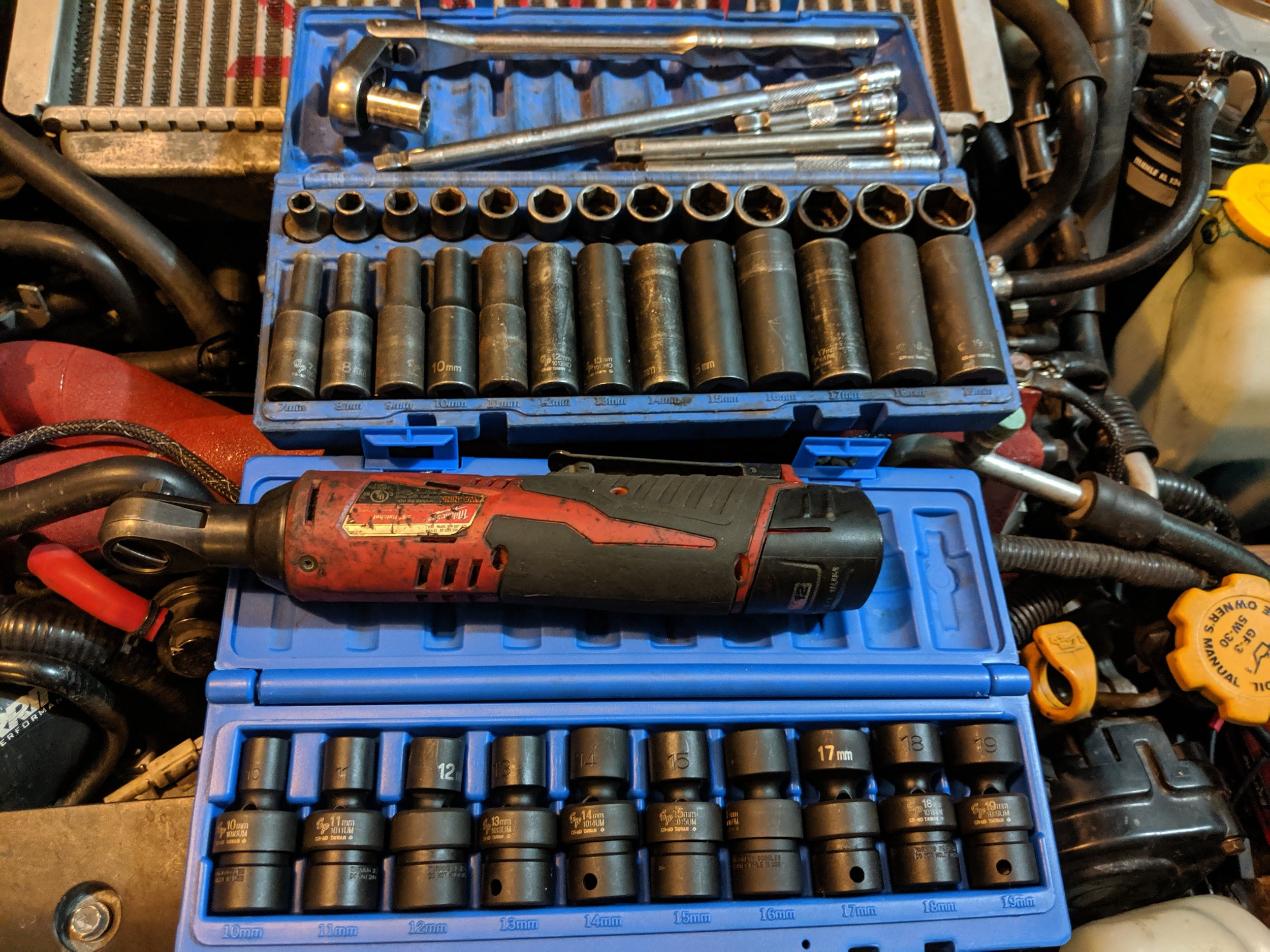 The best of buddies. My 3/8th socket sets from Grey Pneumatic and my Electric ratchet, they spend countless hours together.  Milwaukee 3/8th electric ratchet