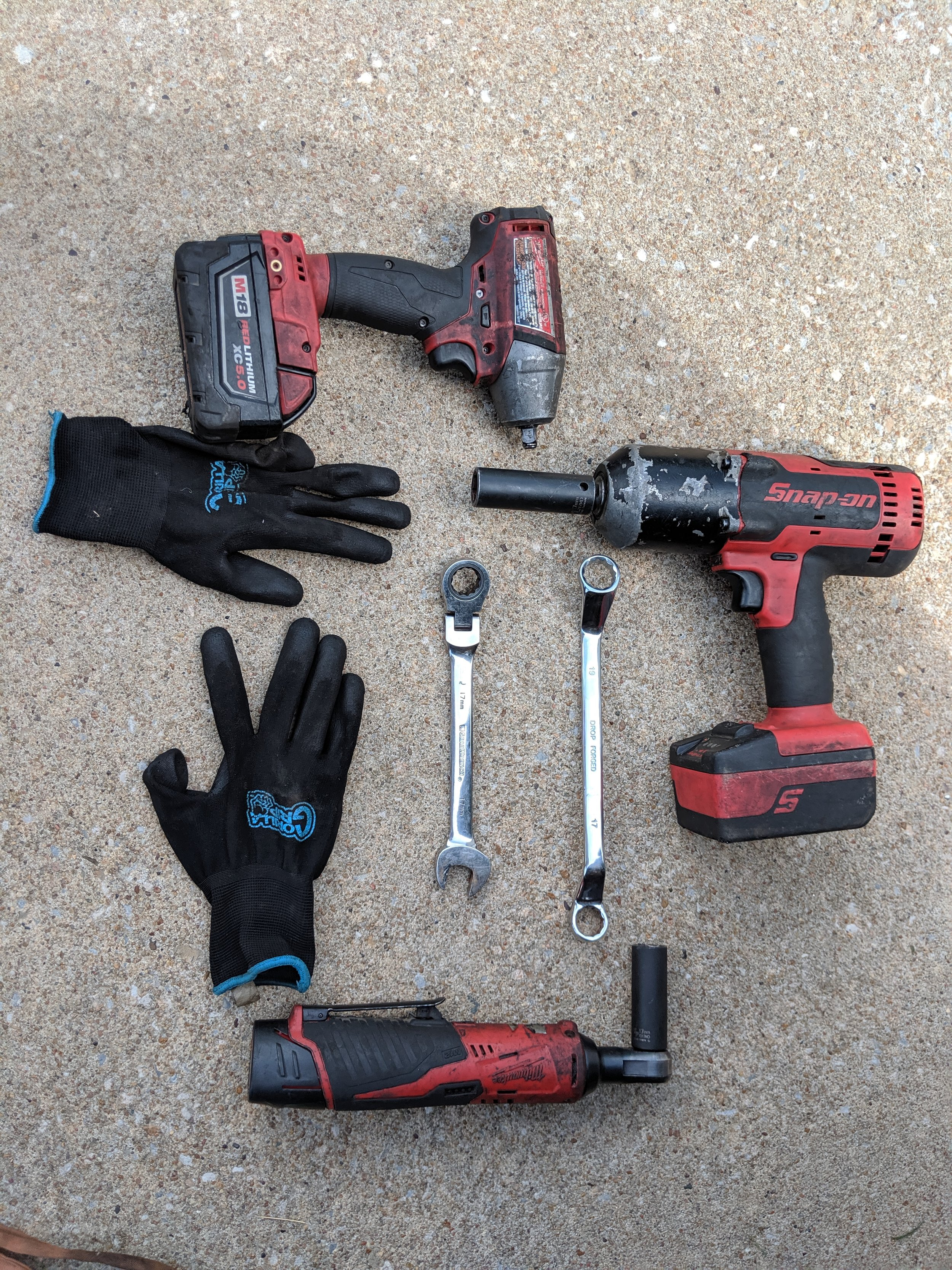 """The usual suspects…. my favorite Milwaukee's 3/8th impact, ratchet and a special guest of my Snap-on 1/2"""" impact. Gorilla gloves and a couple  17mm wrenches  round out the group.   Gearwrench metric ratcheting swivel head wrench set   Gorilla grip large gloves    Gearwrench 3/8ths ratchet   Milwaukee 3/8ths impact gun    Milwaukee 3/8ths electric ratchet"""