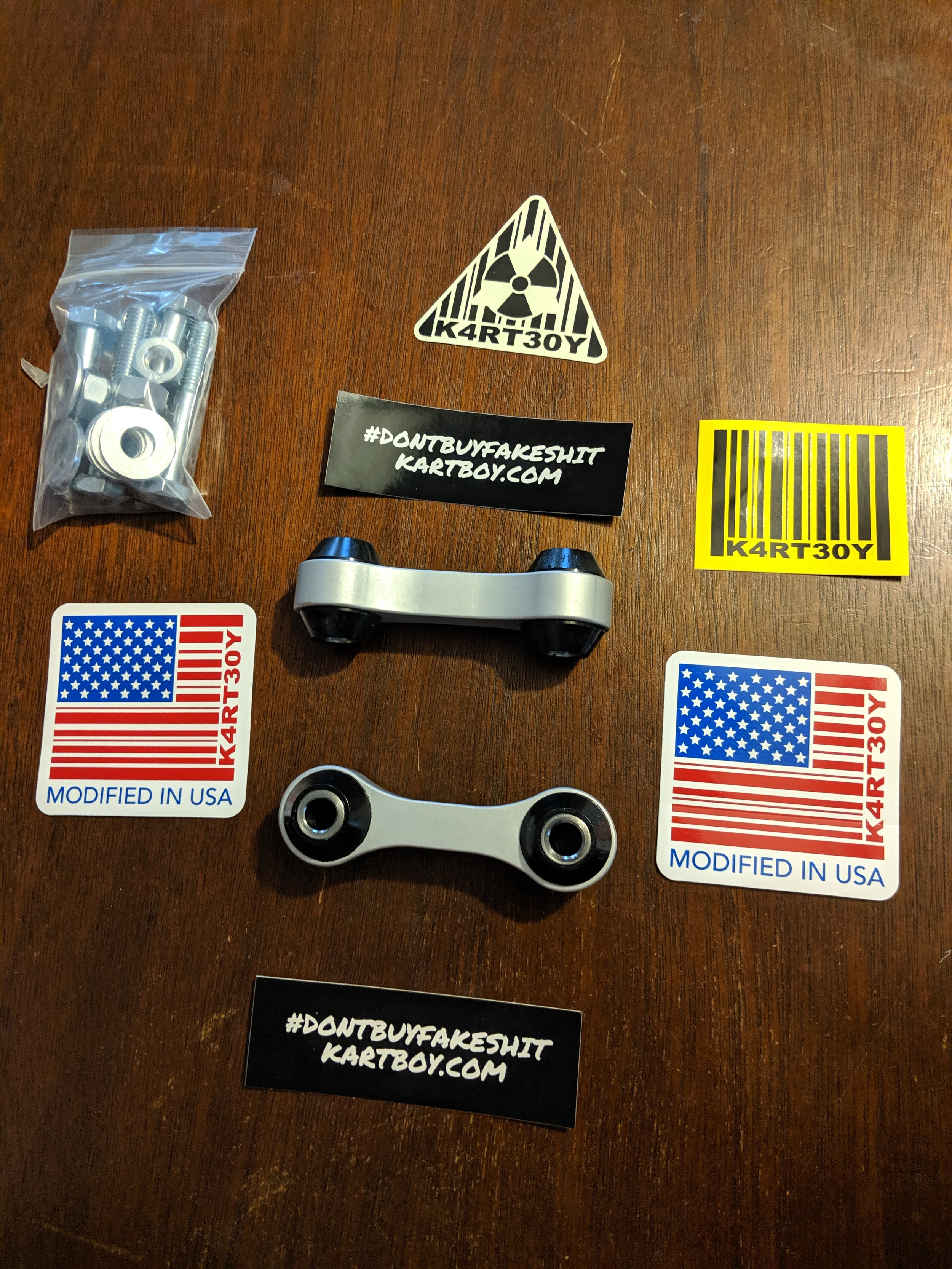 The supplied parts and stickers when you Tom ships these out from his warehouse!  Kartboy rear end links