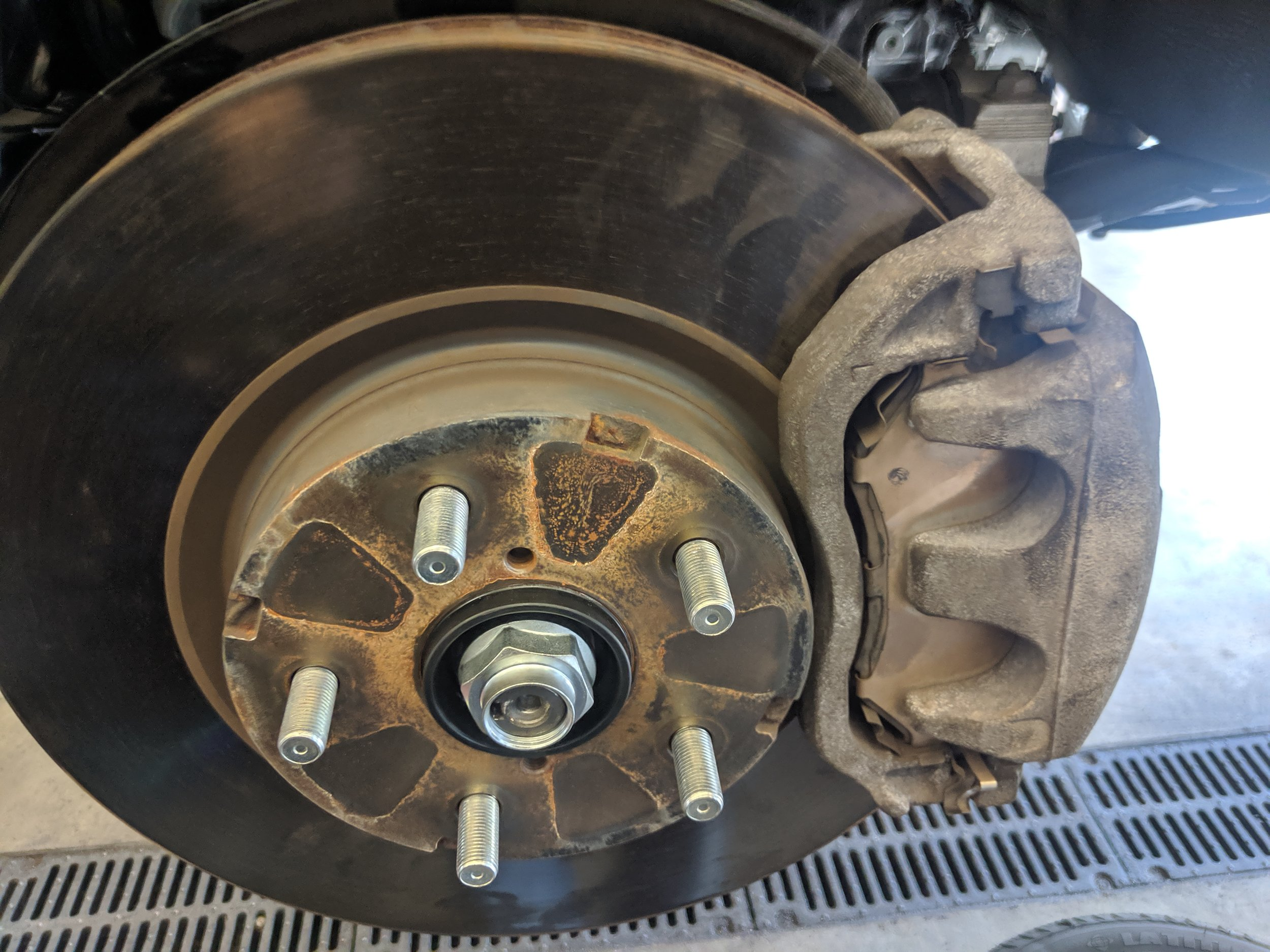 Axle nut loose and ready for removal.