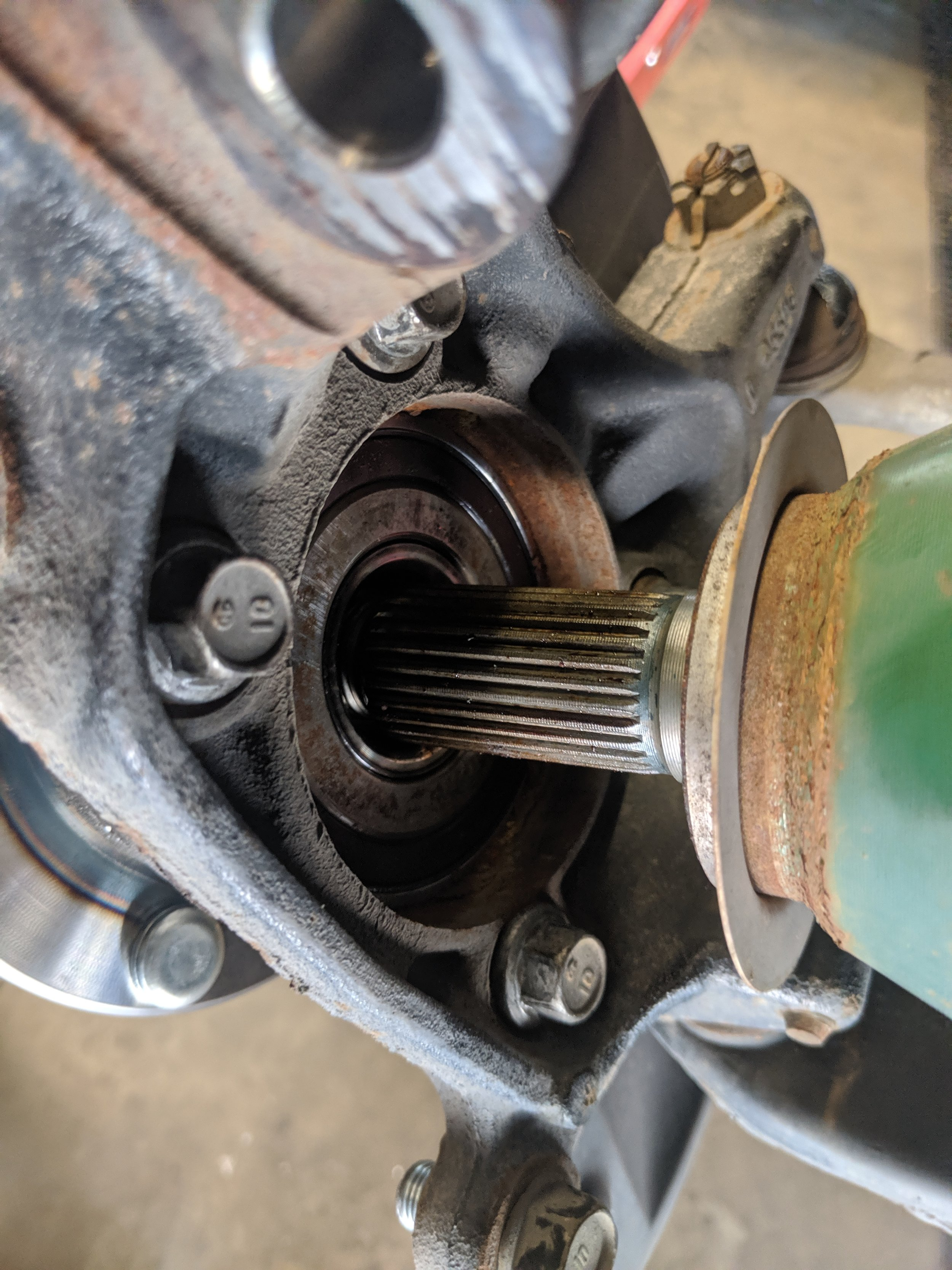 With a bit of force and skill you can now slide the CV axle out or just push it out of your way to get to those bolts.