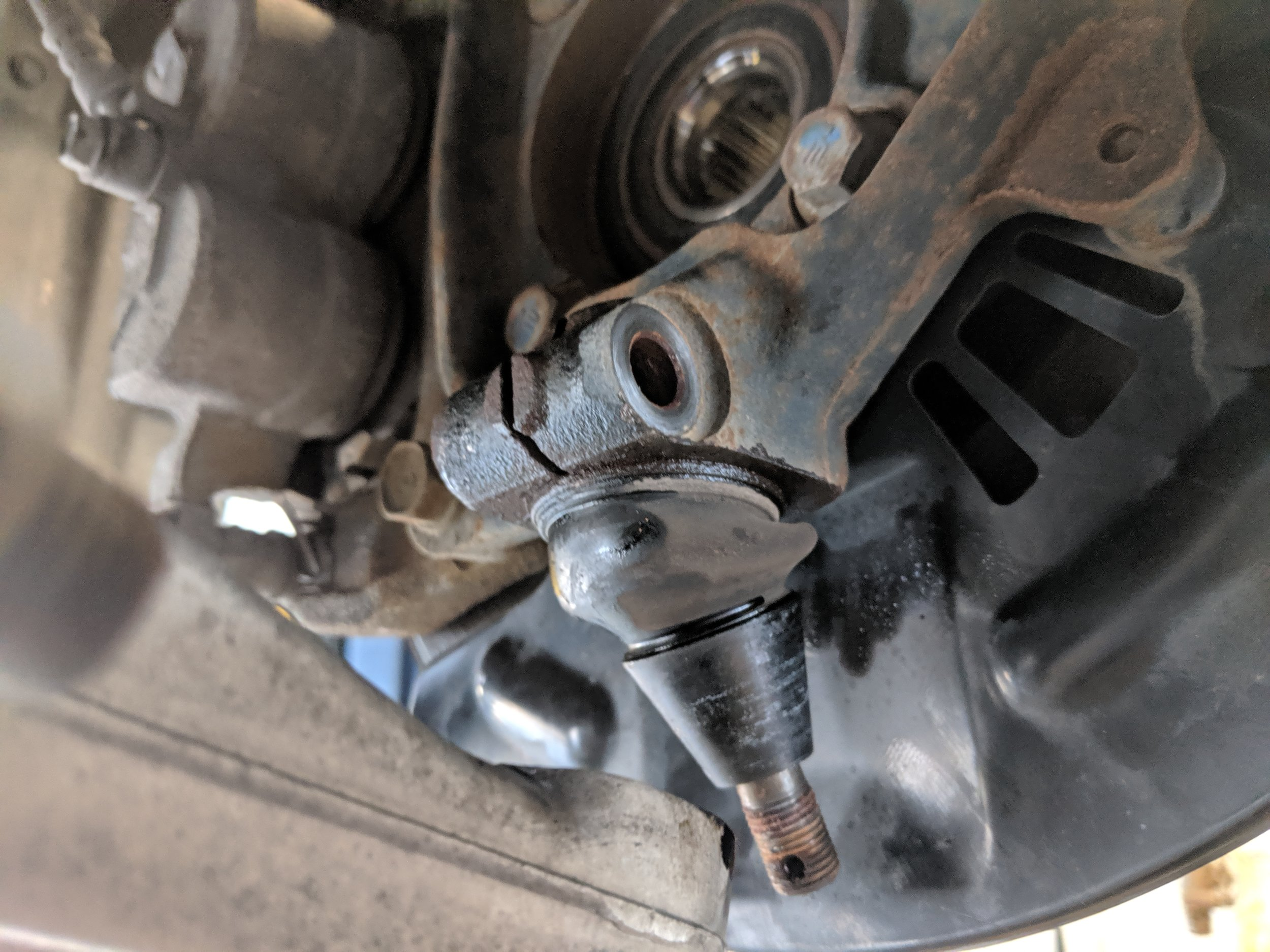 Removing the lower ball joint is the other method to pull the axle shaft out.