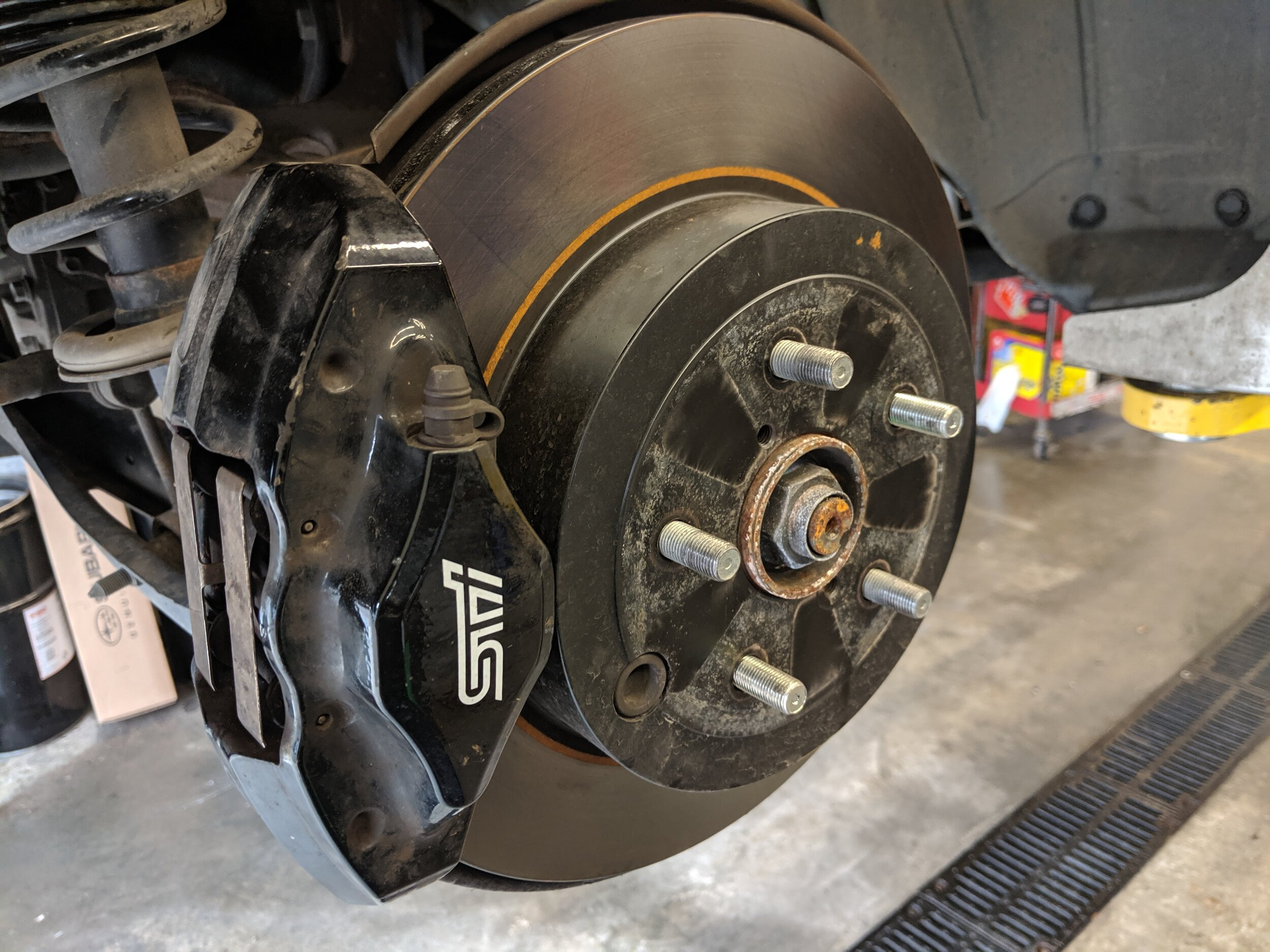 With the wheel removed we can see where we need to be. Removing the caliper and rotor is our upcoming steps.