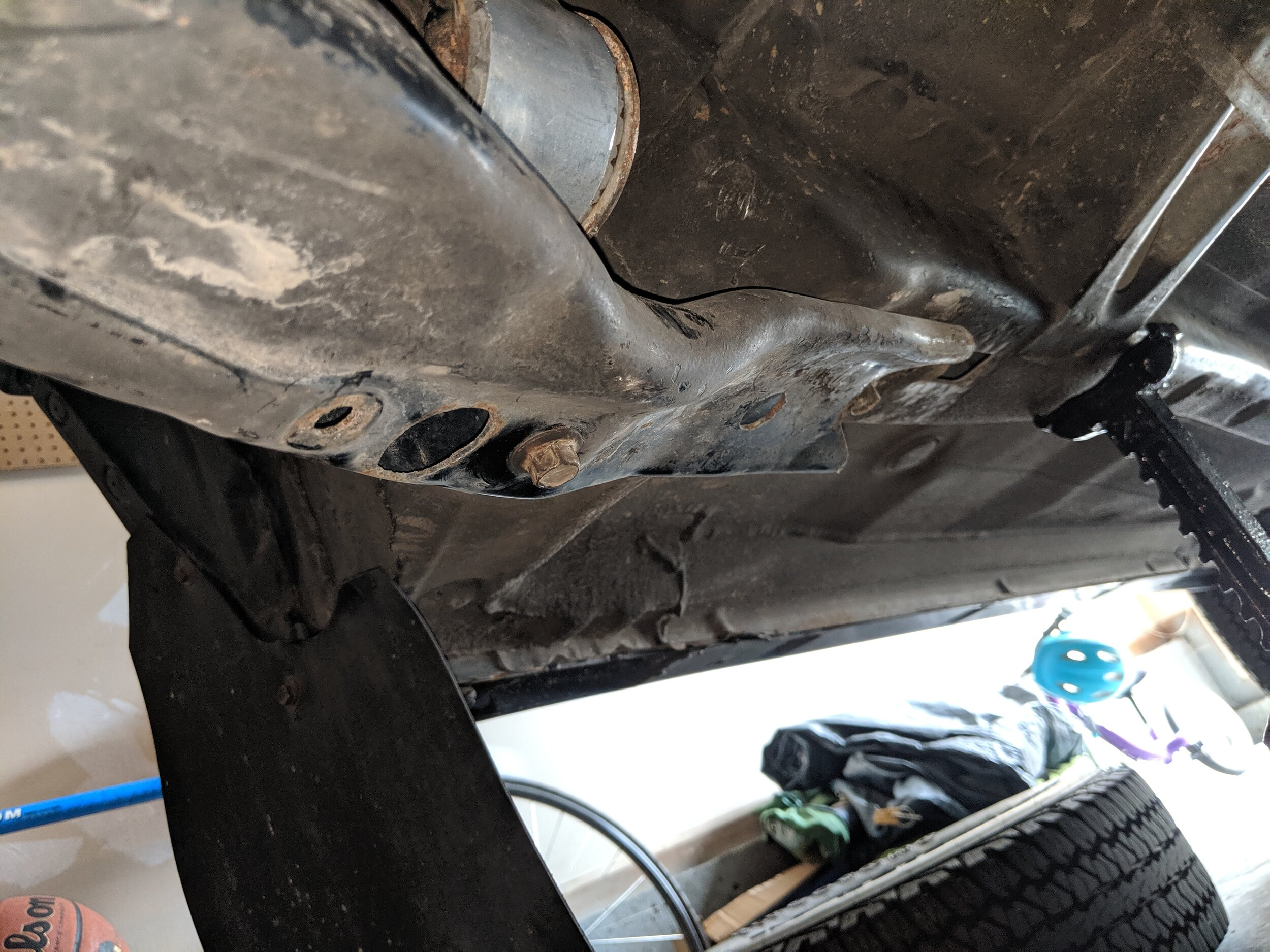If you aren't removing the subframe there is one of the holes to allow you to loosen the transverse mount and remove the arm. Otherwise you can remove the bolt in the center and far right to complete the removal of the subframe.