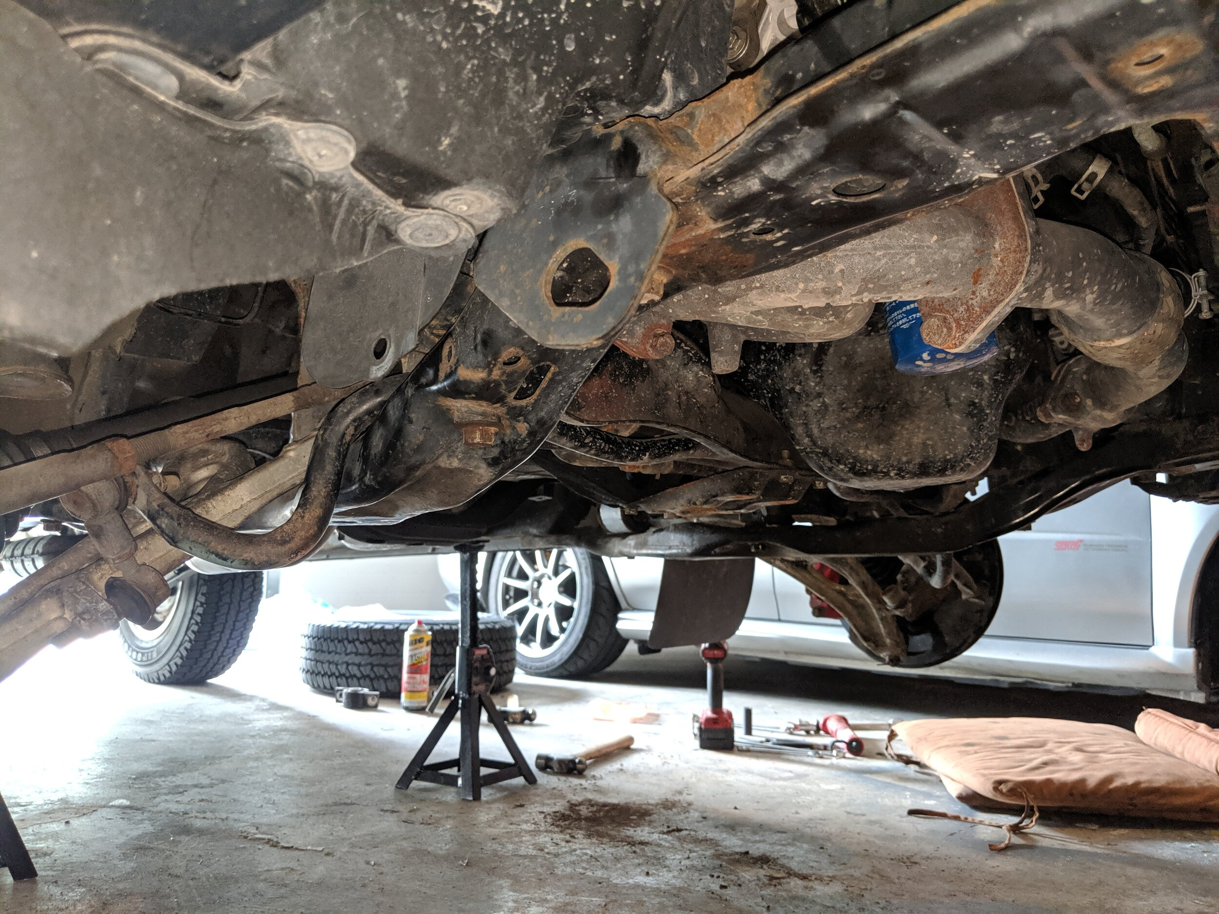 Subframes back on and arms in their spots. We are ready to lower this car back down.