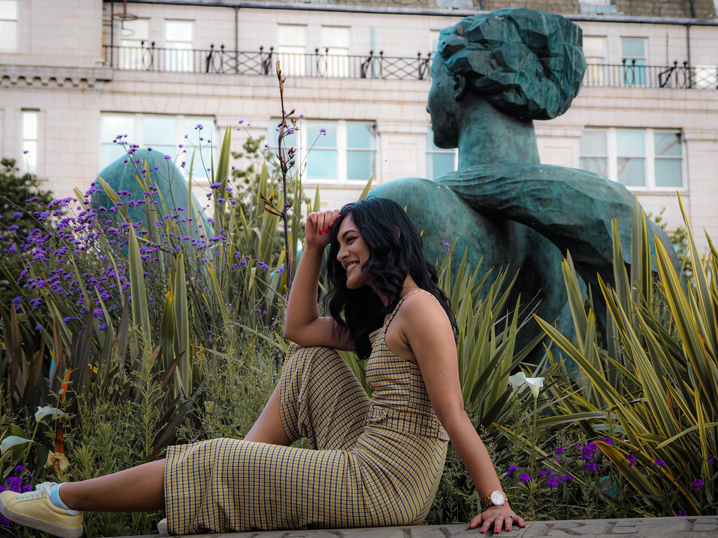Ariya out posing a statue