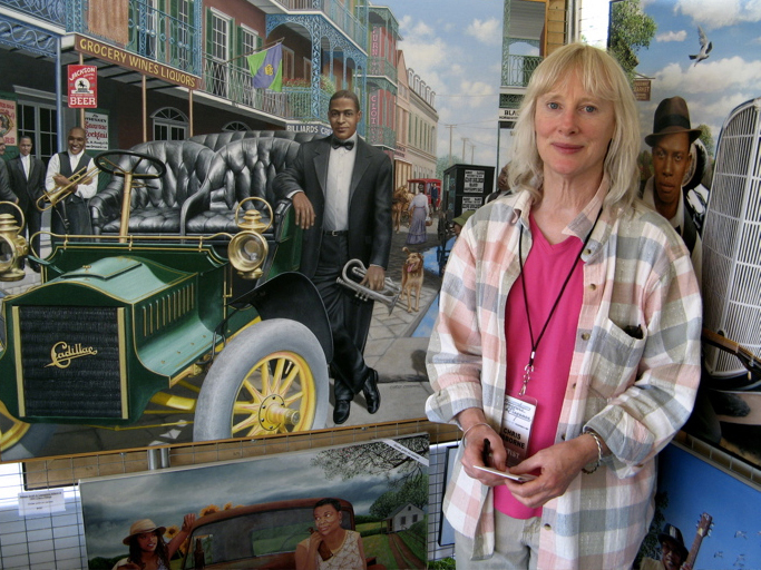 Chris Osborne with her painting of Buddy Bolden.