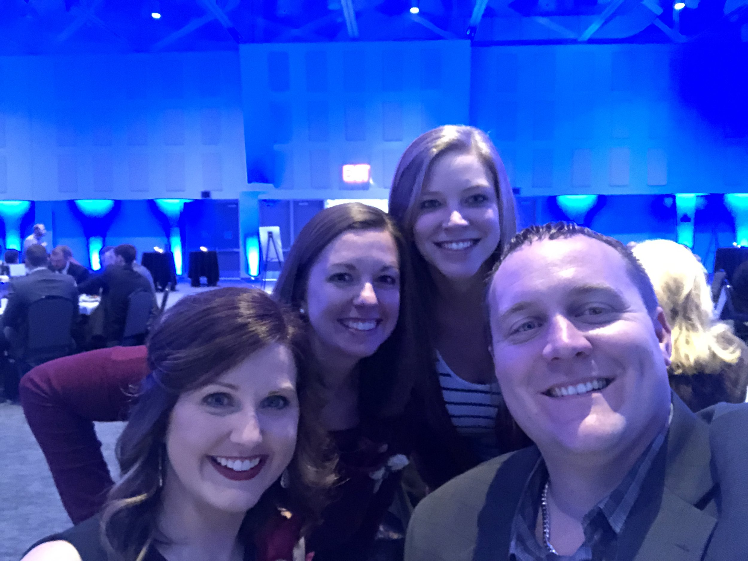 Back- Gabby and Haley from the Kore Cares Team Front- Last Year's Rising in Excellence award winner Steff Liston-Holtrop and the SME member who nominated Gabby for the award, Derek Kattenberg