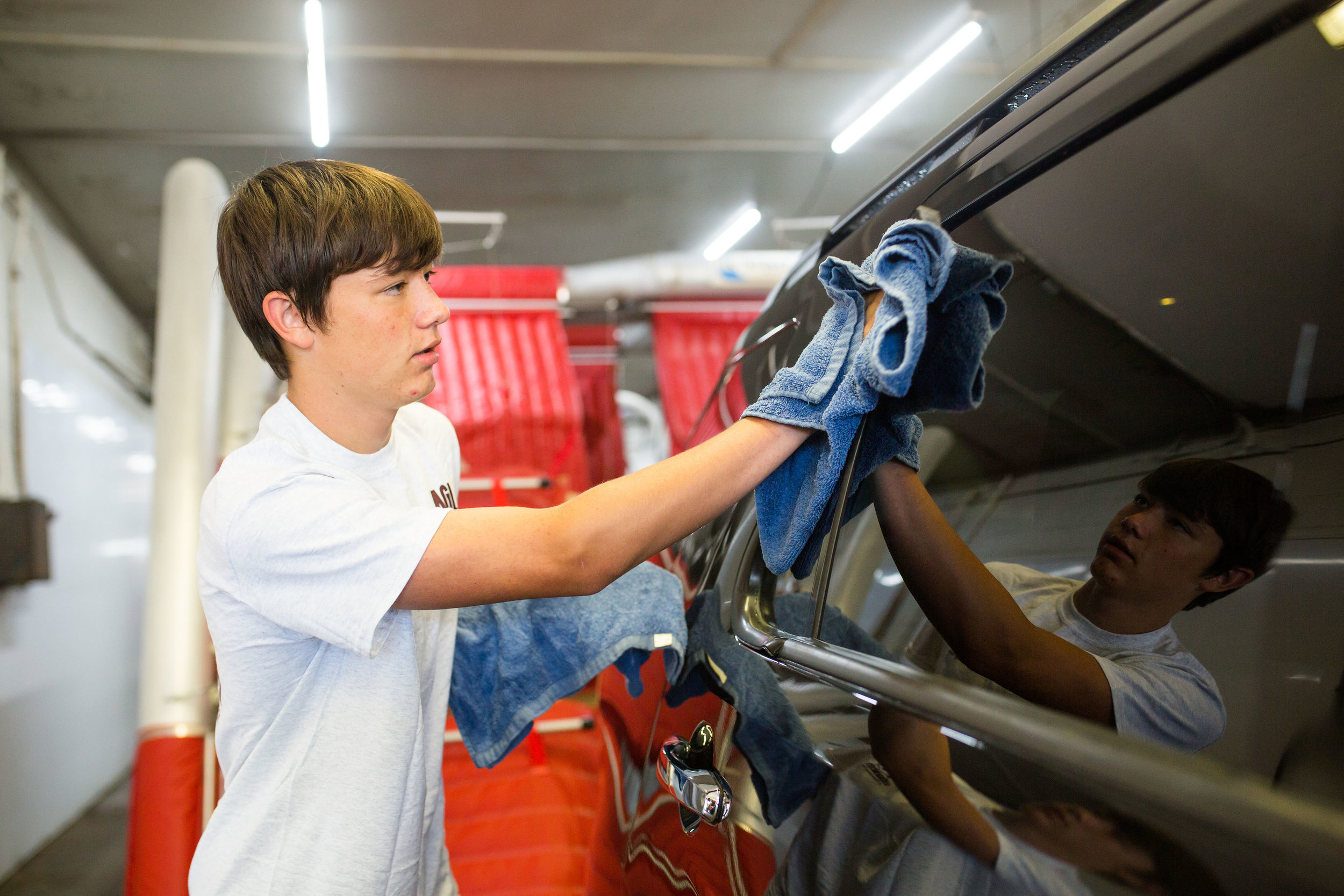 Quinton Zwiesler, a 16-year-old student and employee at Eagle Auto Wash, is scheduled for just two hours on school days to allow time for chores and homework in the evenings.