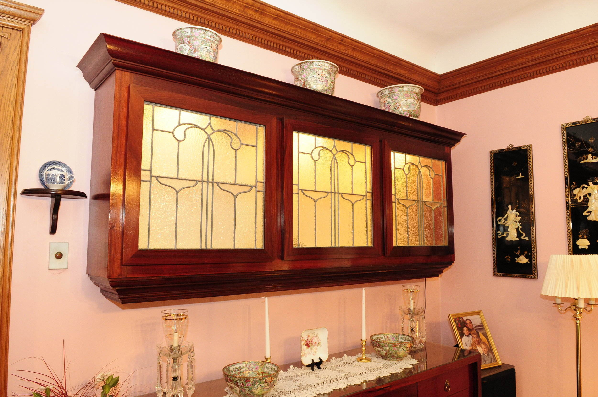 Larry designed and built this Cabinet and Credenza made from Paduc and Purple Heart woods.