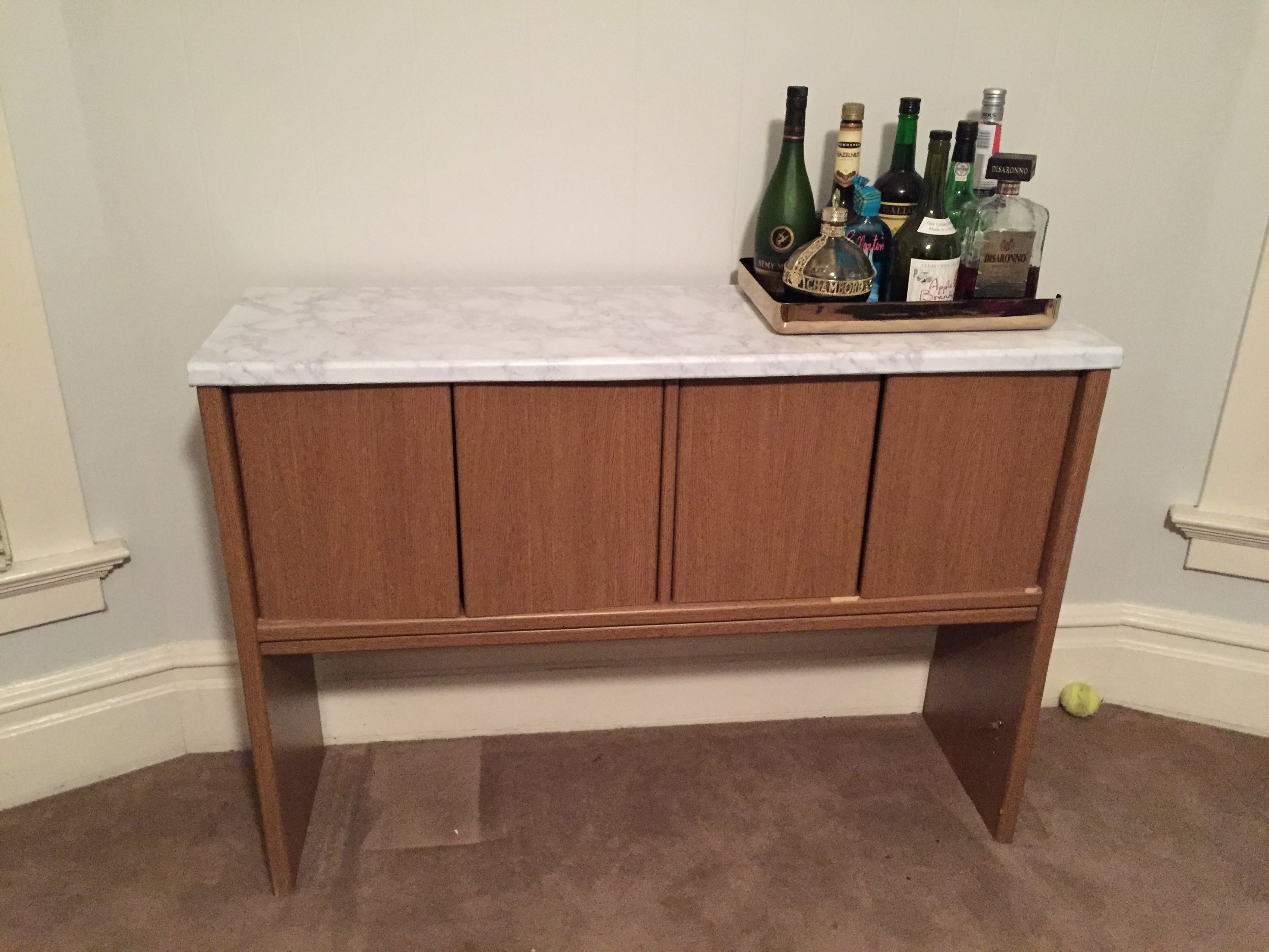 A craigslist find that Kristy improved with marble contact paper. -