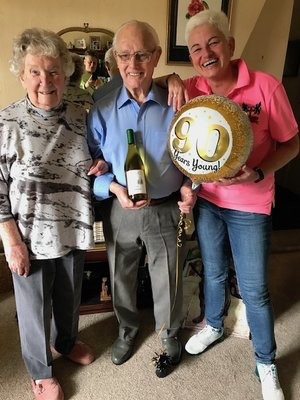 Bryan Adlum with his wife and Jackie celebrating his 90th birthday