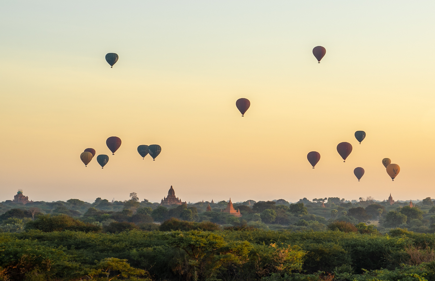 Hot air balloons fly over Bagan, just after sunrise.