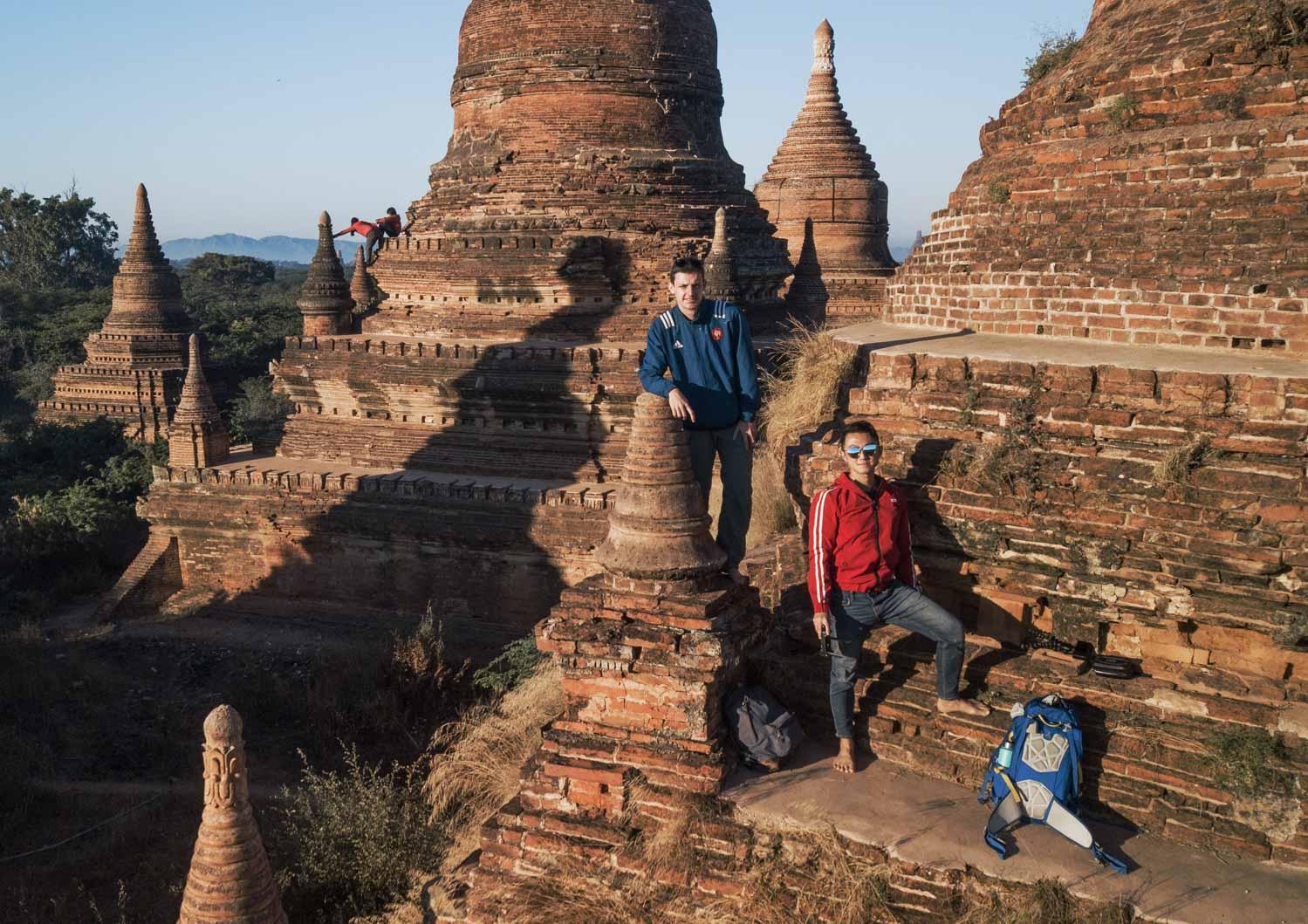 Blue and Red: Guys posing on Bagan stupa climb
