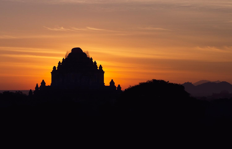 Bagan Sunrise: Sun behind Sulamani Temple silhouette.