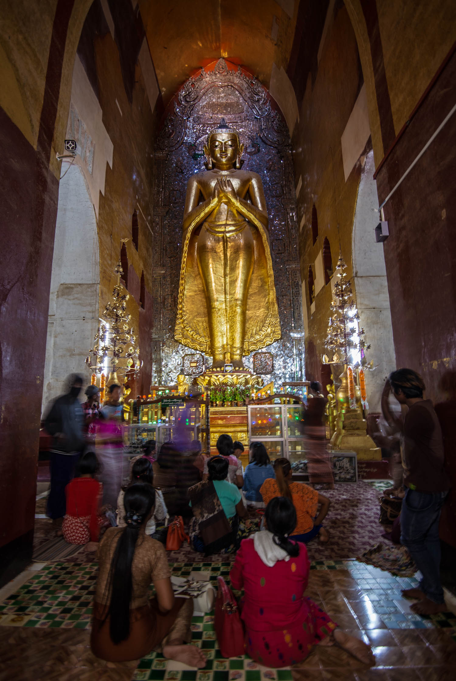Devotees engage with the Buddha at the Ananda Phaya Temple in Bagan.