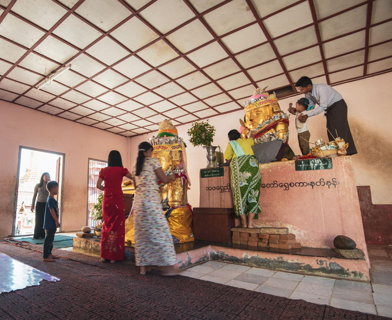 Family worship of the Nats (indigenous Burmese spirits) at Shwezigon Pagoda in Bagan.