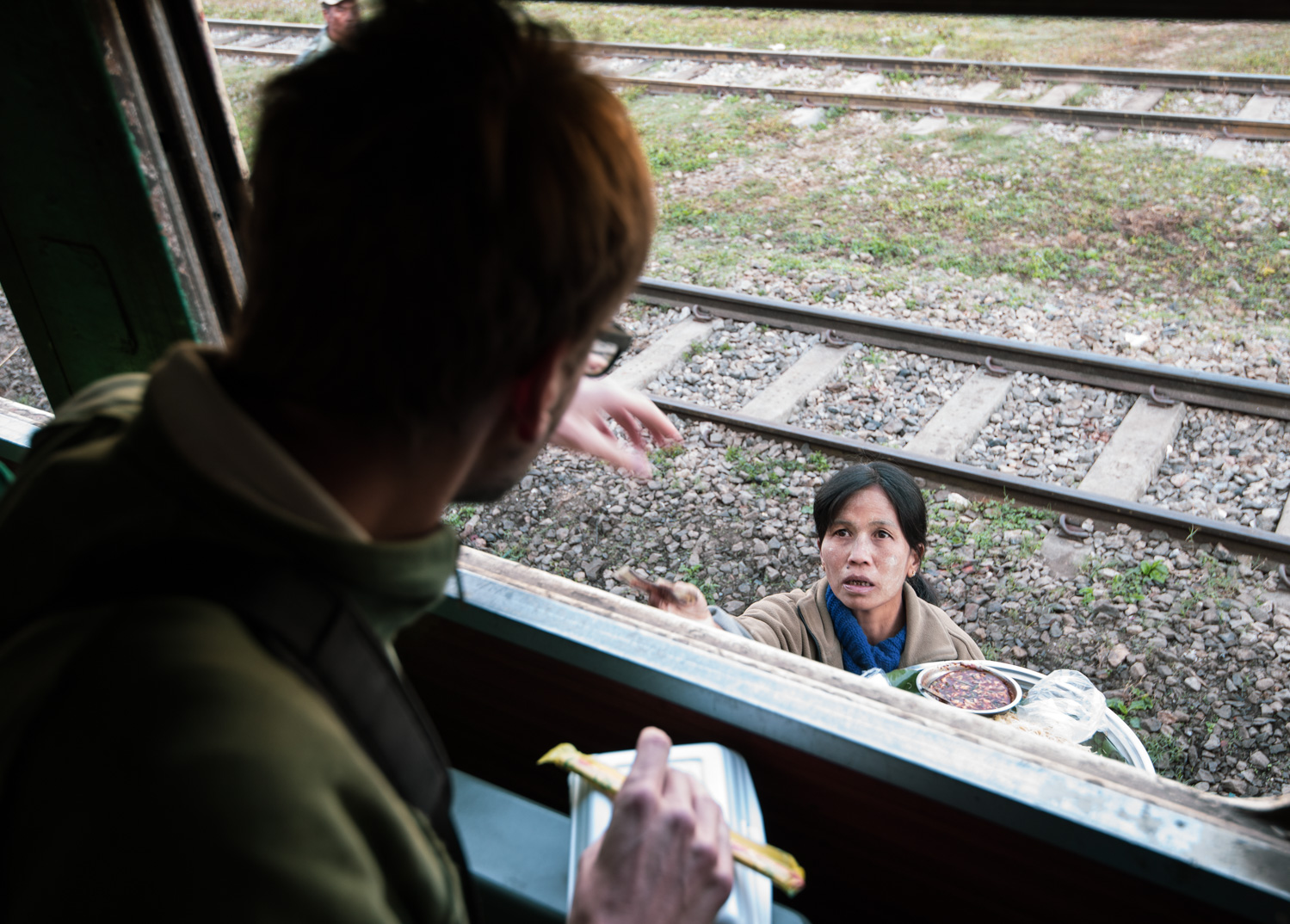 Buying noodles from a roaming vendor from the Mandalay-Lashio (Gokteik) train window.