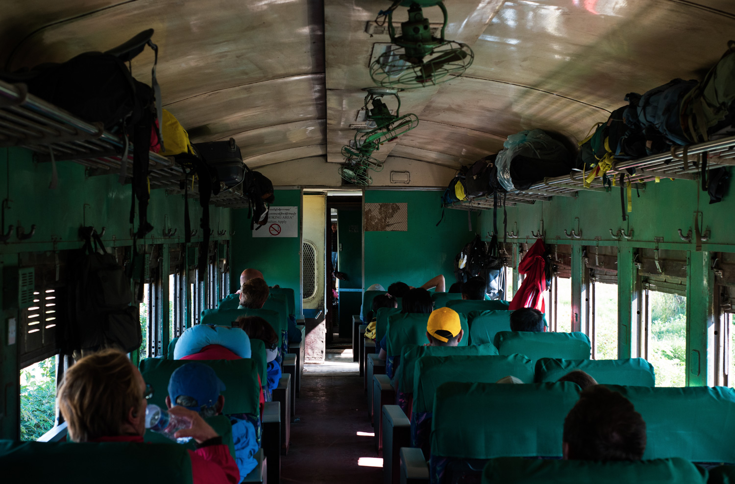 The green interior of the Mandalay-Lashio Gokteik train carriage with its old furnishings (most of which don't function).
