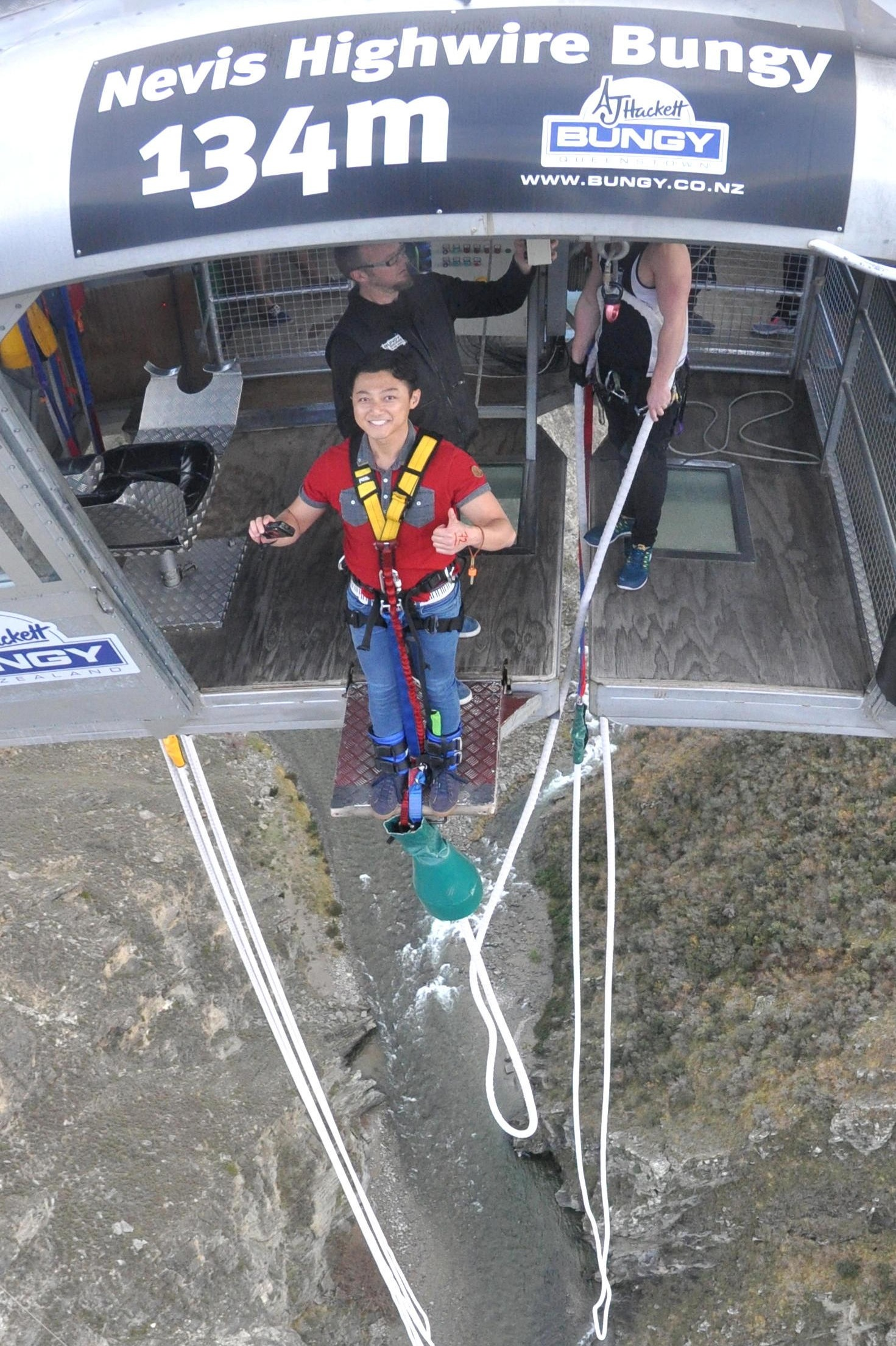 Stepping out onto the ledge. Getting ready for the 134m jump of faith.