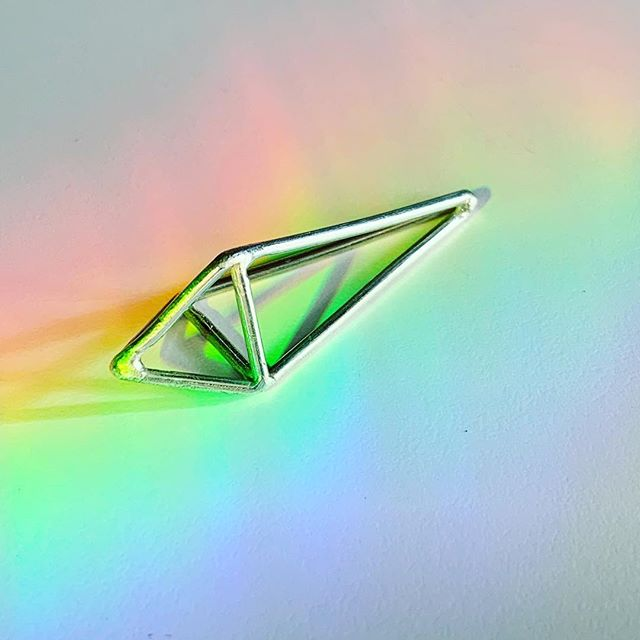 absorb the light, transform the light • PRISMS : hand-modeled in wax and cast in reclaimed sterling + fine silvers. • • • #fuse93 #handmadeincolorado #coloradomade #geometricjewelry #prisms #prismatic #prism #wireframe #geometricart #geometricdesign #minimalista #spectrum #polygon #polyhedron #instasmithy #ladysmith #jewelrydesign #etsysellersofig #rainbowart #rainbows #linework #fortcollinsco #fortcollinsart #coloradojewelry
