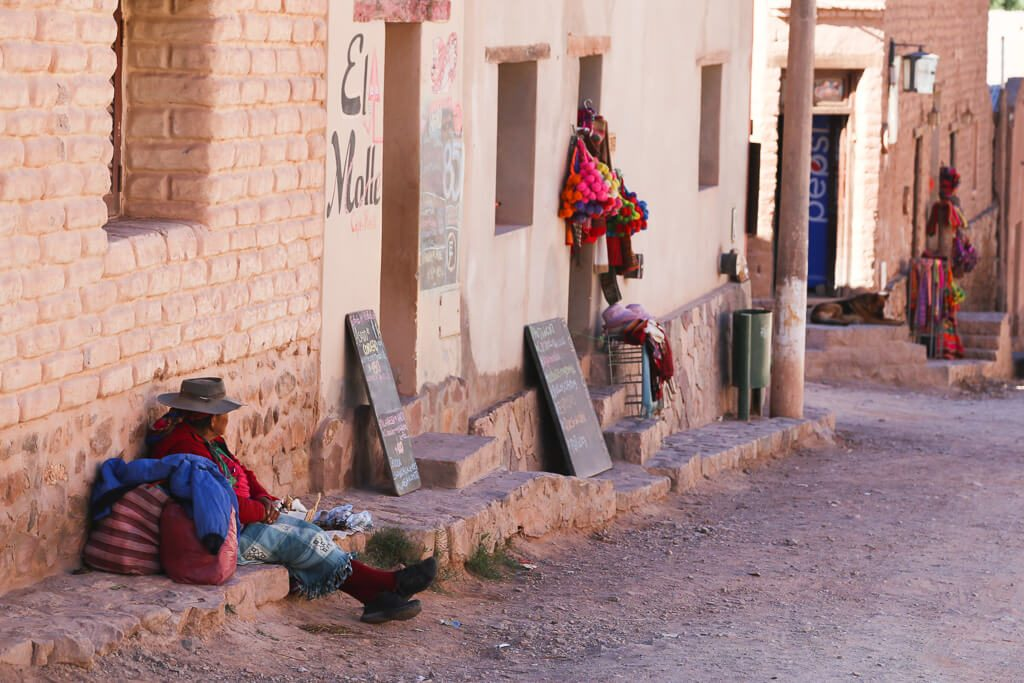 Small village of Purmamarca a woman sells coca leaves in Jujuy