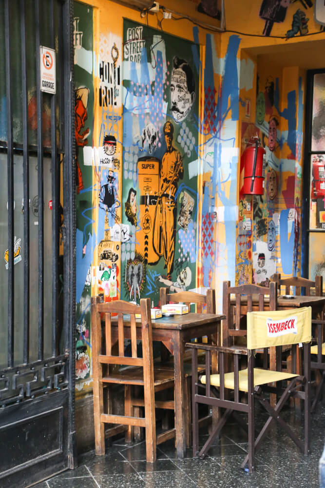 Street art and tables and chairs at a restaurant in Palermo Soho
