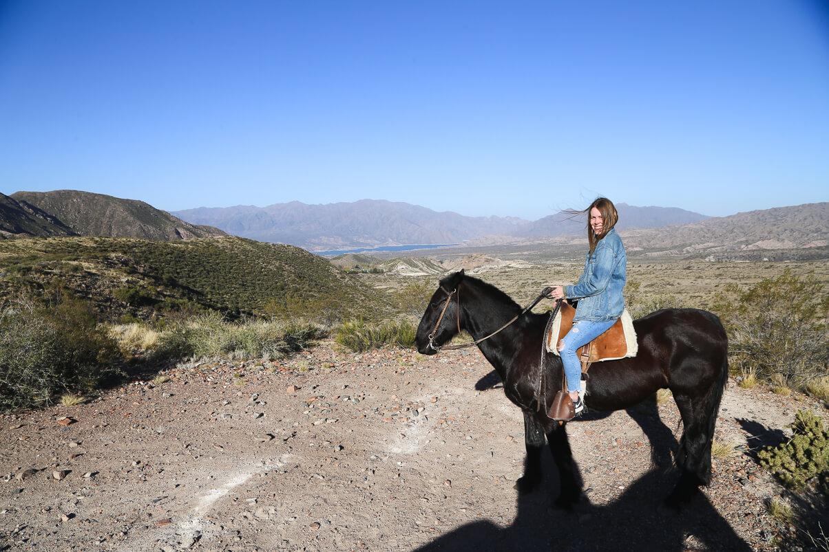 On my horse overlooking the reservoir in Potrerillos