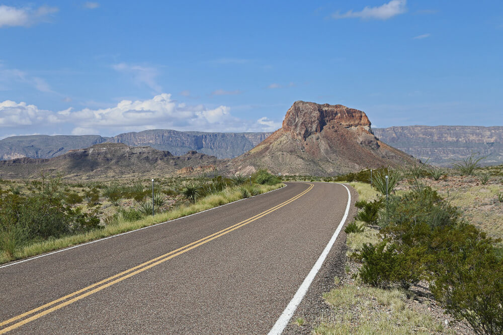 A long highway amidst the desert inRoss Maxwell Scenic Drive in Big Bend National Park