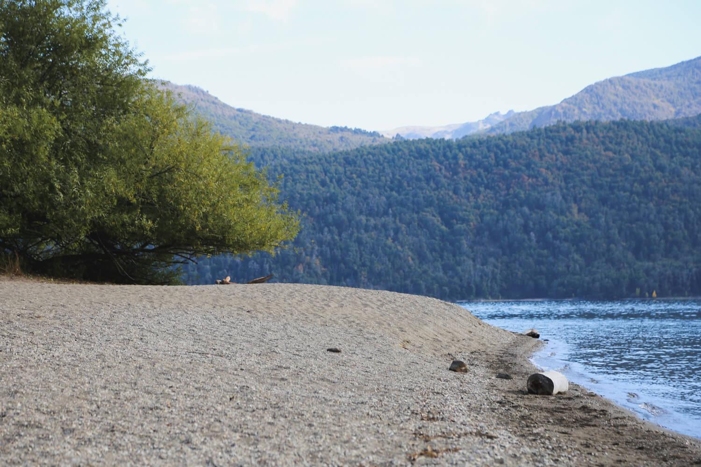 A quiet beach next to a lake in san martin de los andes argentina