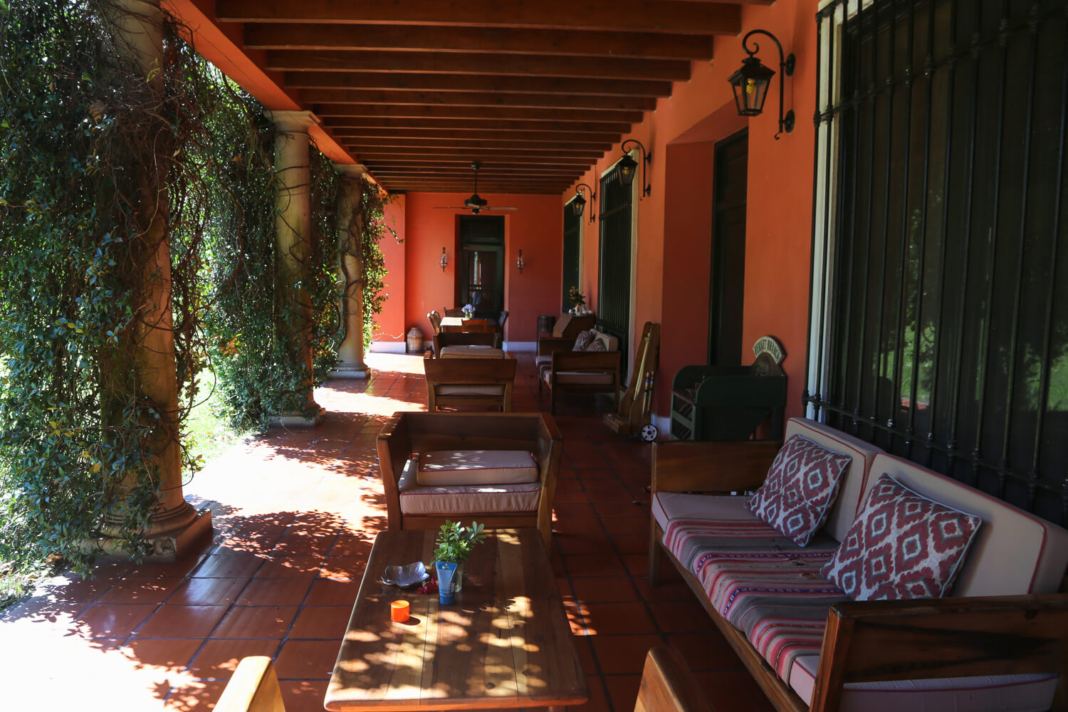 A patio filled with lounge seating and antique tables at Estancia la Bandada