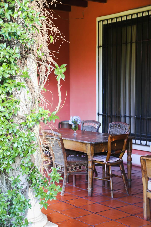 An antique table in a gallery patio at Estancia la Bandada Argentina