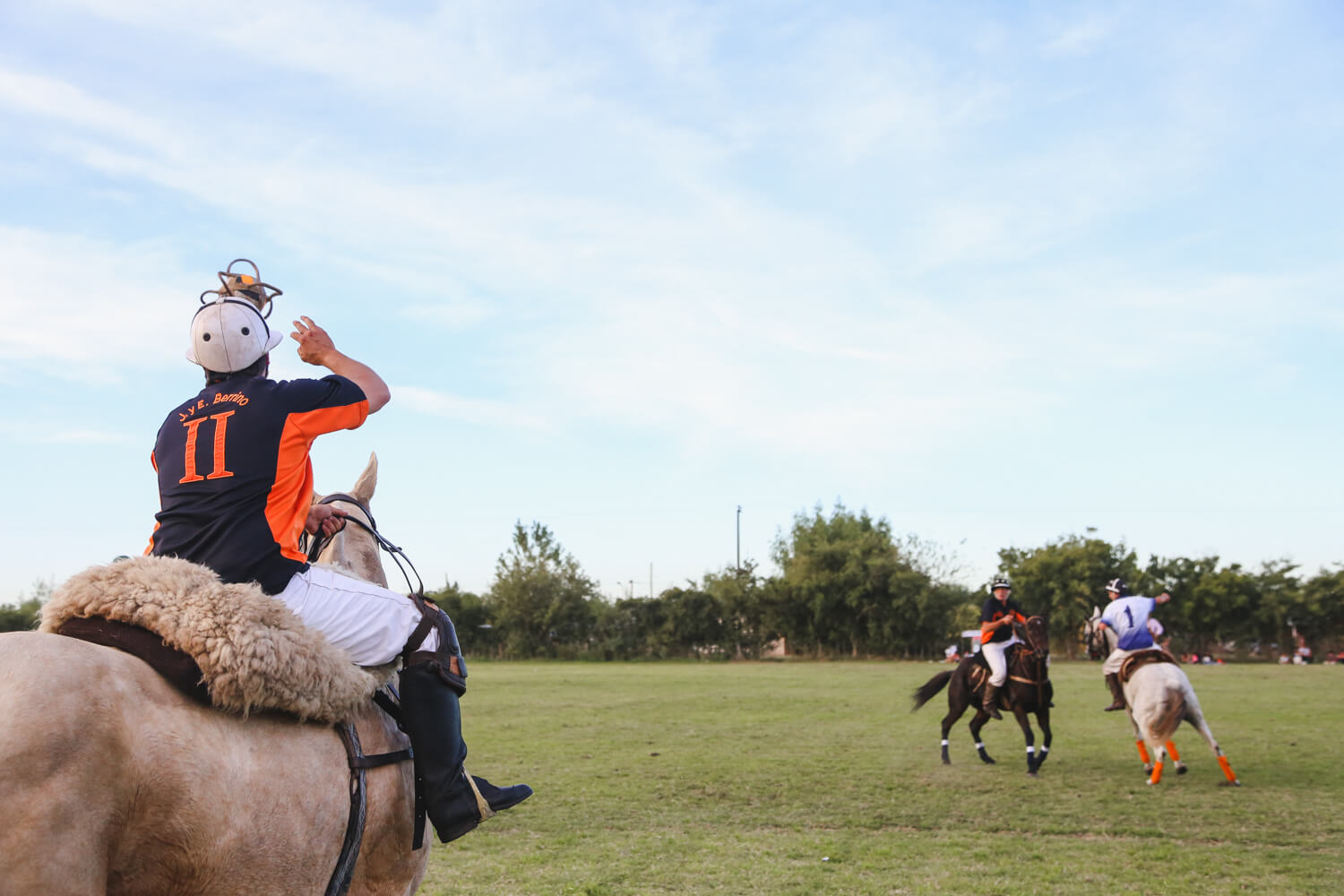 A player on horseback throws a ball for the start of Pato Argentina's National Sport