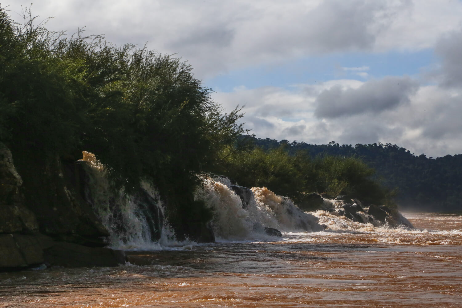 A long row of waterfalls pour into the Uruguay River at the Saltos del Mocona