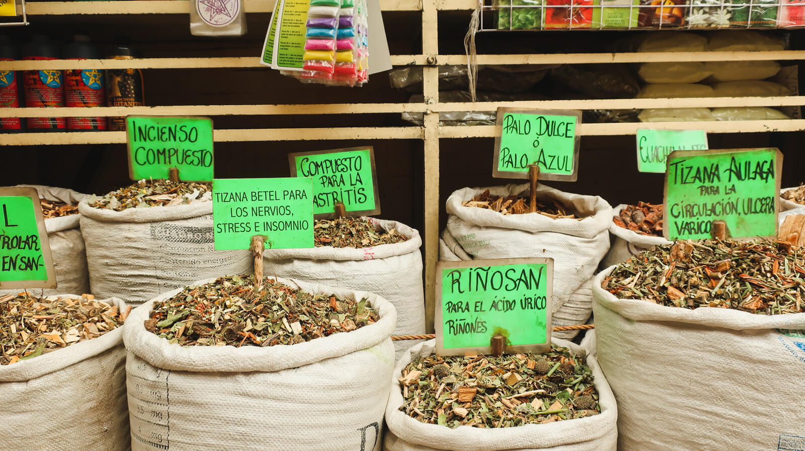 Medicinal herbs for homeopathic remedies sit in bags on a Mexico City market tour