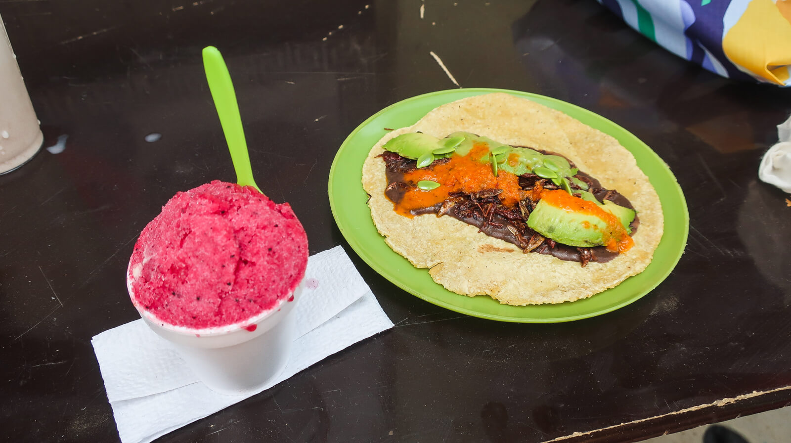 My prickly pear sorbet and Ly's cricket taco to end a successful Mexico City market tour.