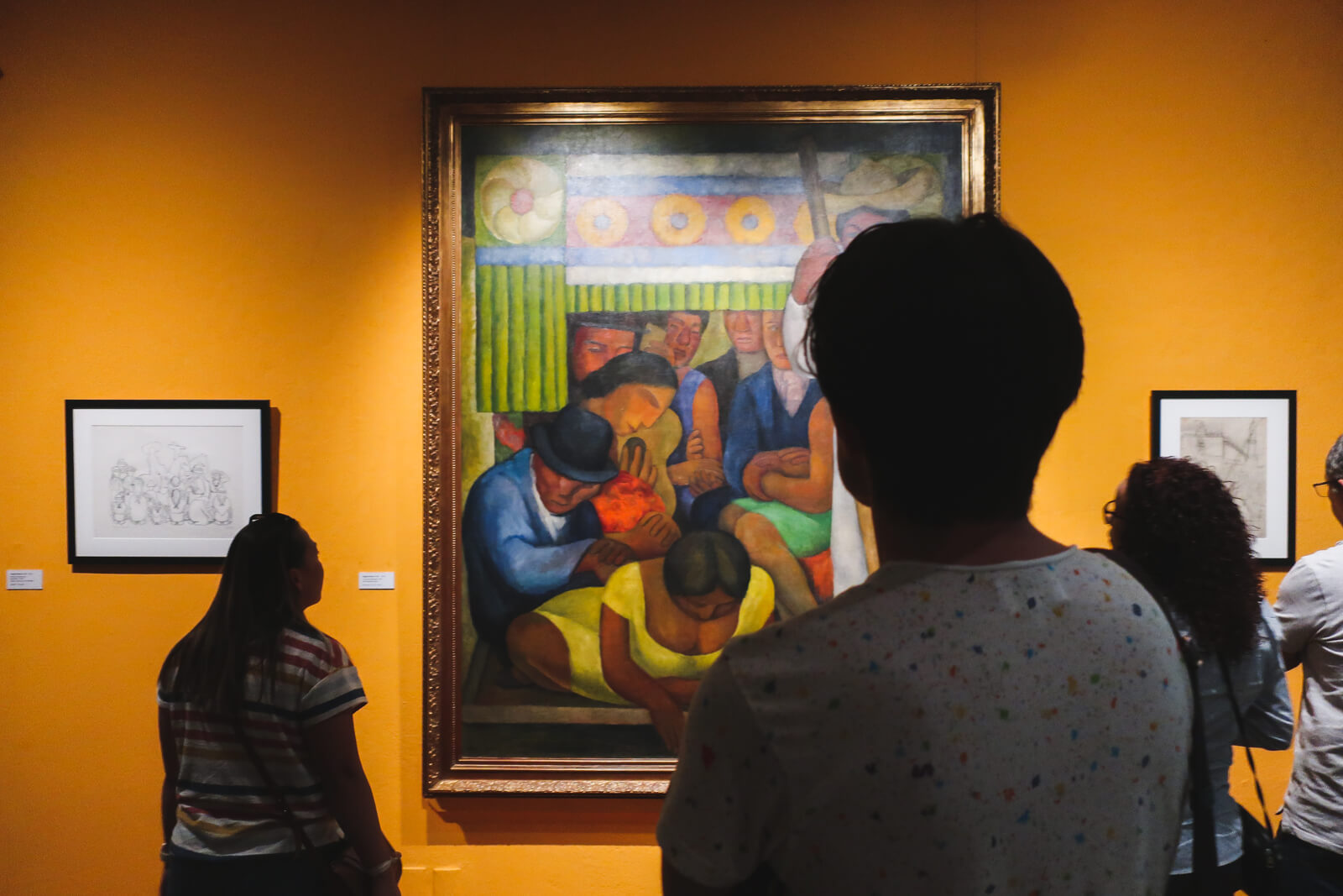 My friends looking at Diego Rivera's painting of Xochimilco while in Xochimilco.