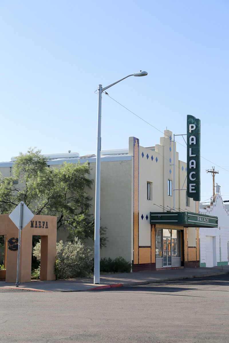 A historic theater stands on a quiet street in a small town in West Texas