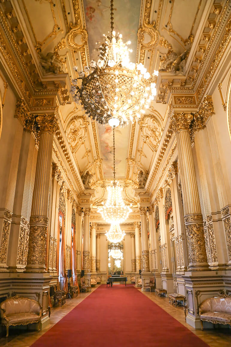 An opulent gold leafed hallway of the Teatro Colon Opera House in Buenos Aires