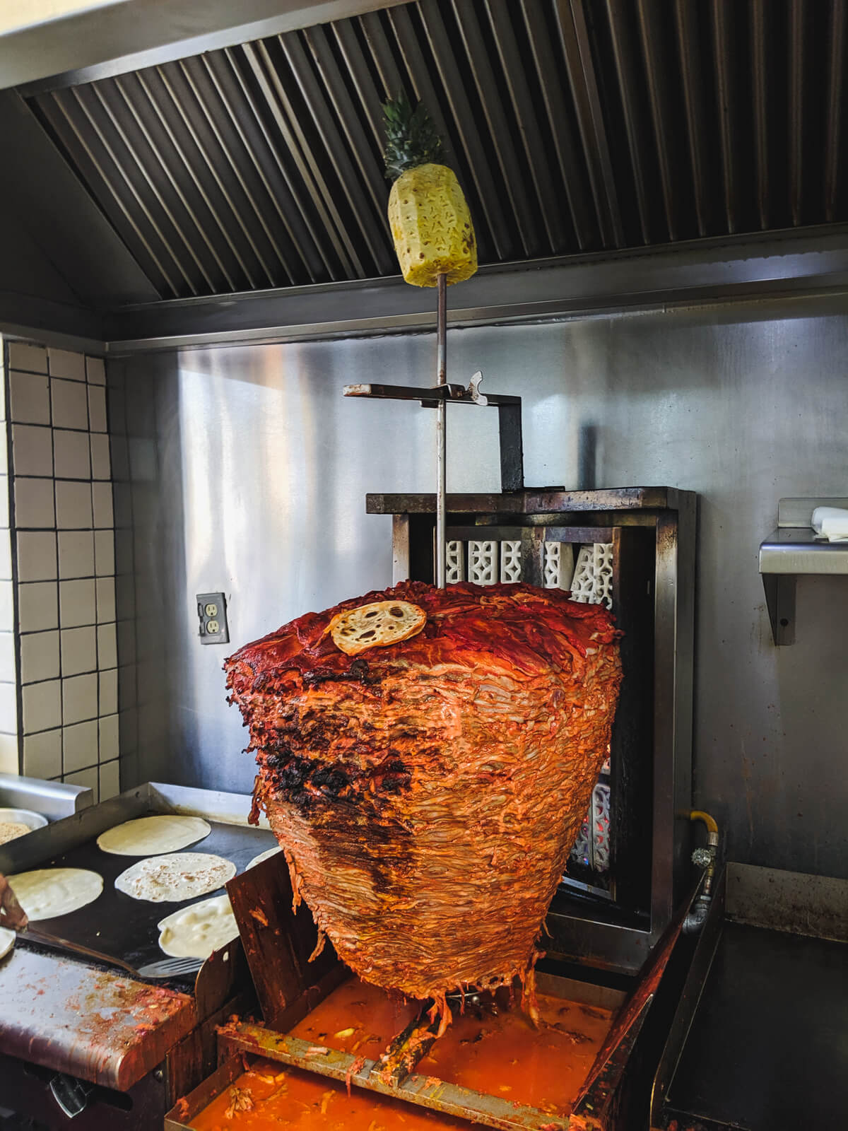 This is a trompo, the spit-roasted pork that becomes a taco al pastor. This particular (massive) trompo is at Orinoco.