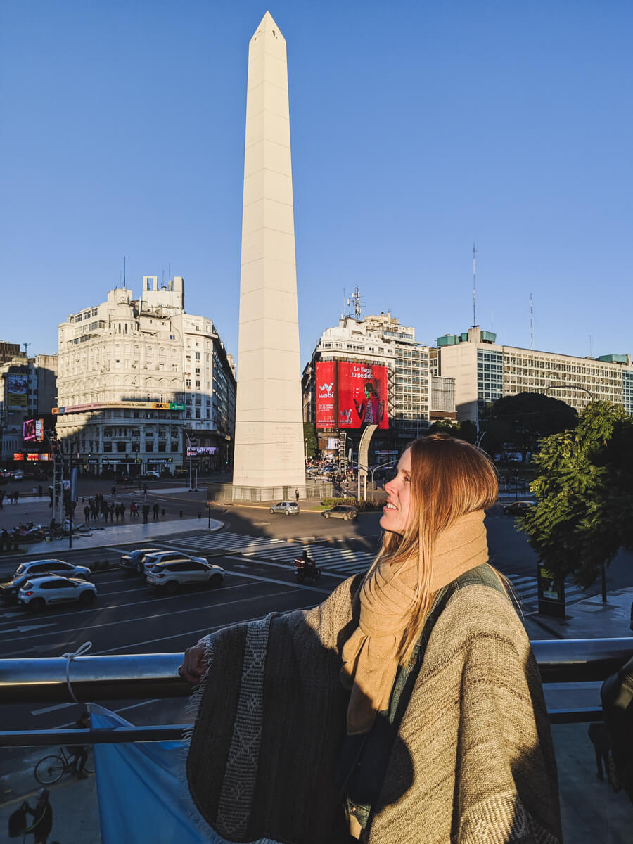 A woman stands in front of the obelisk in downtown Buenos Aires