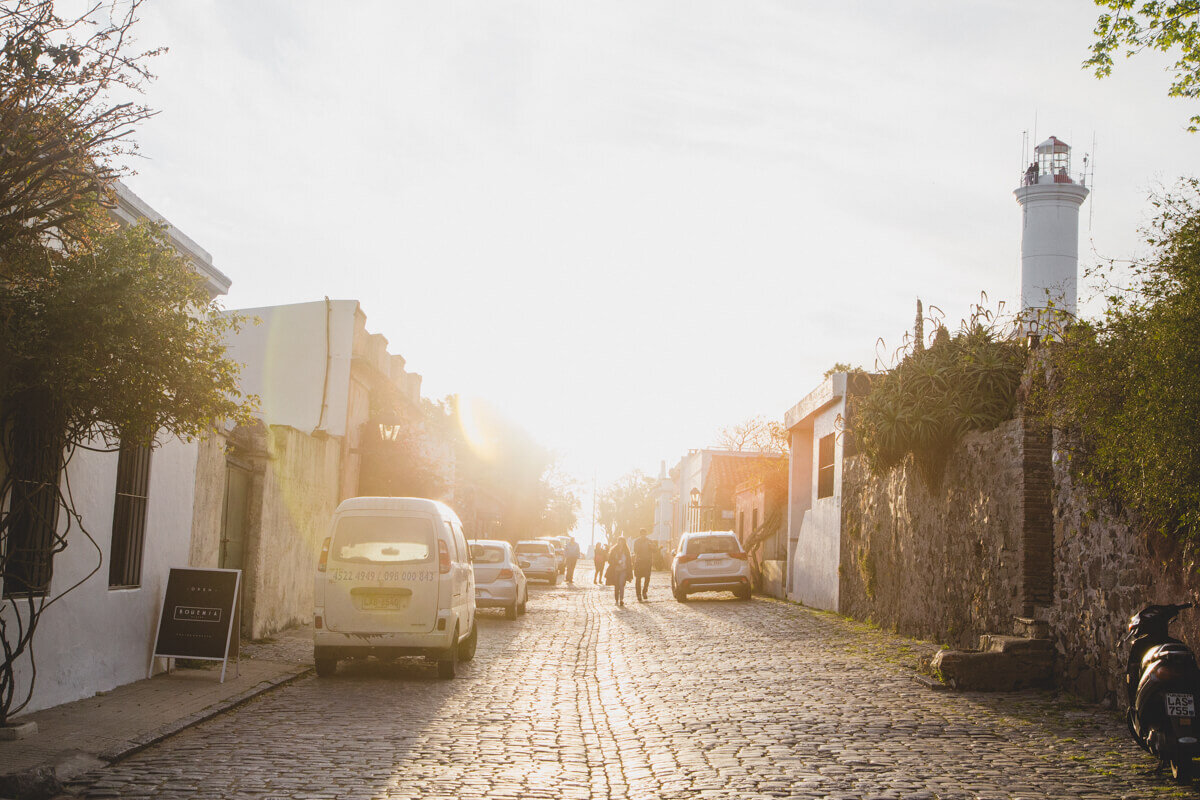 The sun sets on a cobblestone street on a Colonia del Sacramento Buenos Aires day trip