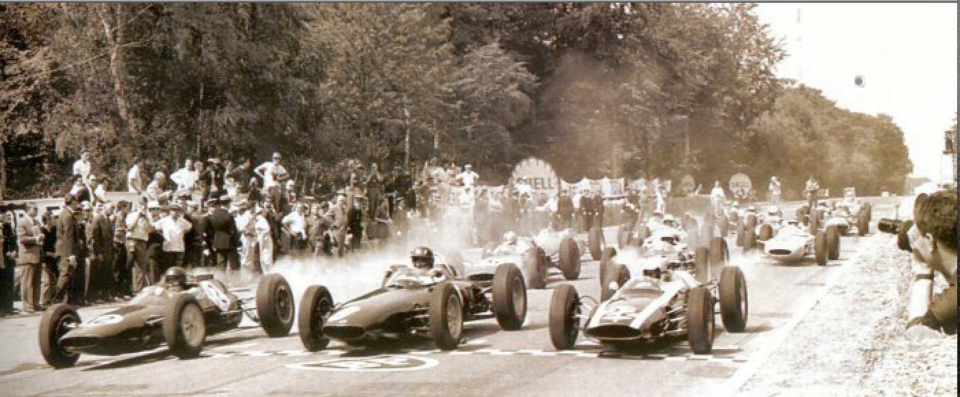 The start of the French Grand Prix at Rouen in 1962 and also the start of my career as a cameraman. I am one of the guys standing behind the grid with a camera (a 16mm Kodak K100 with a wind up motor). I had stumbled into the job during my 11th grade summer vacation in Europe. My instructions for this shot was to walk out among the last cars on the grid, turn the camera on when they raised the flag, and film until the motor ran down.