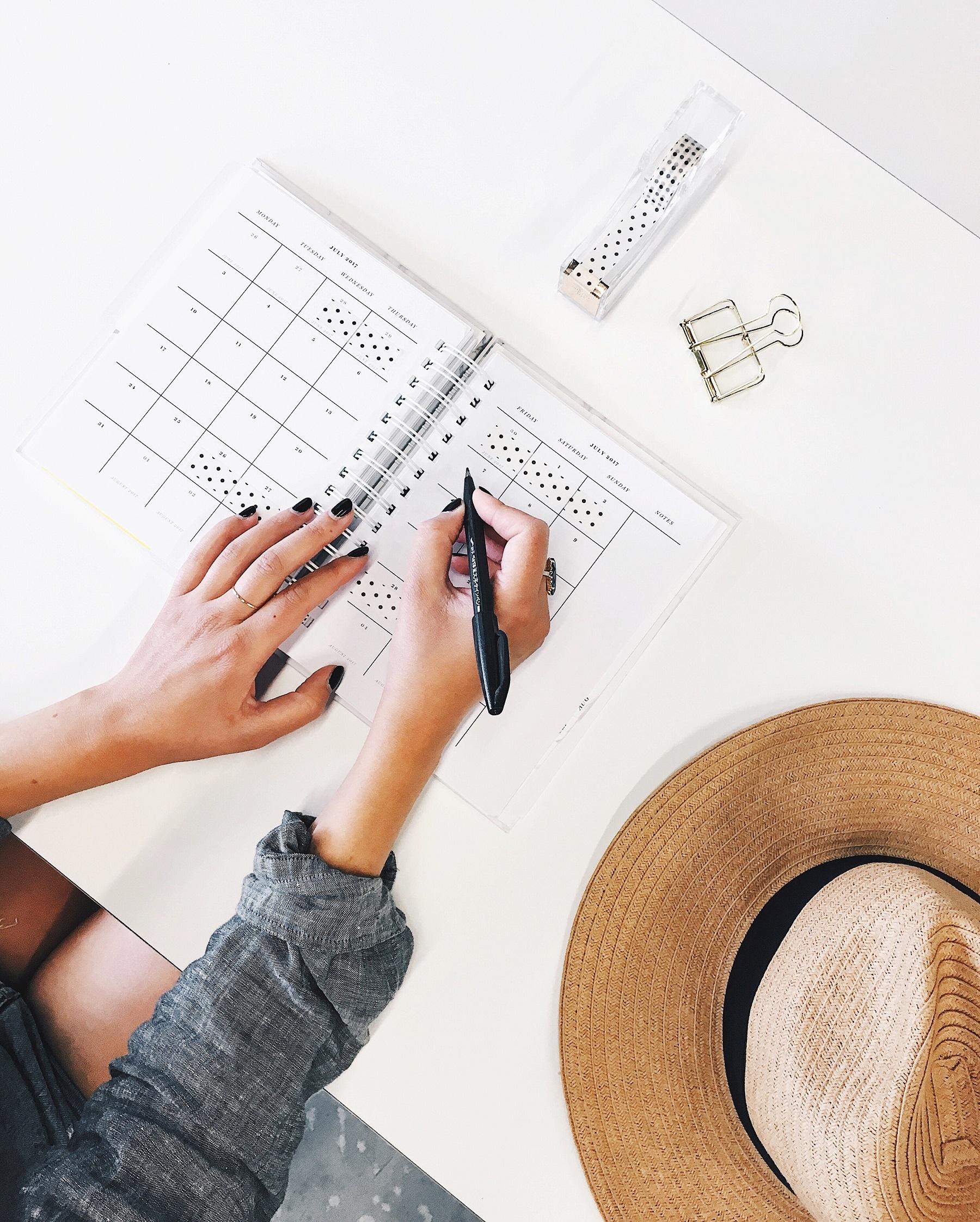 Woman writing in work planner.jpg