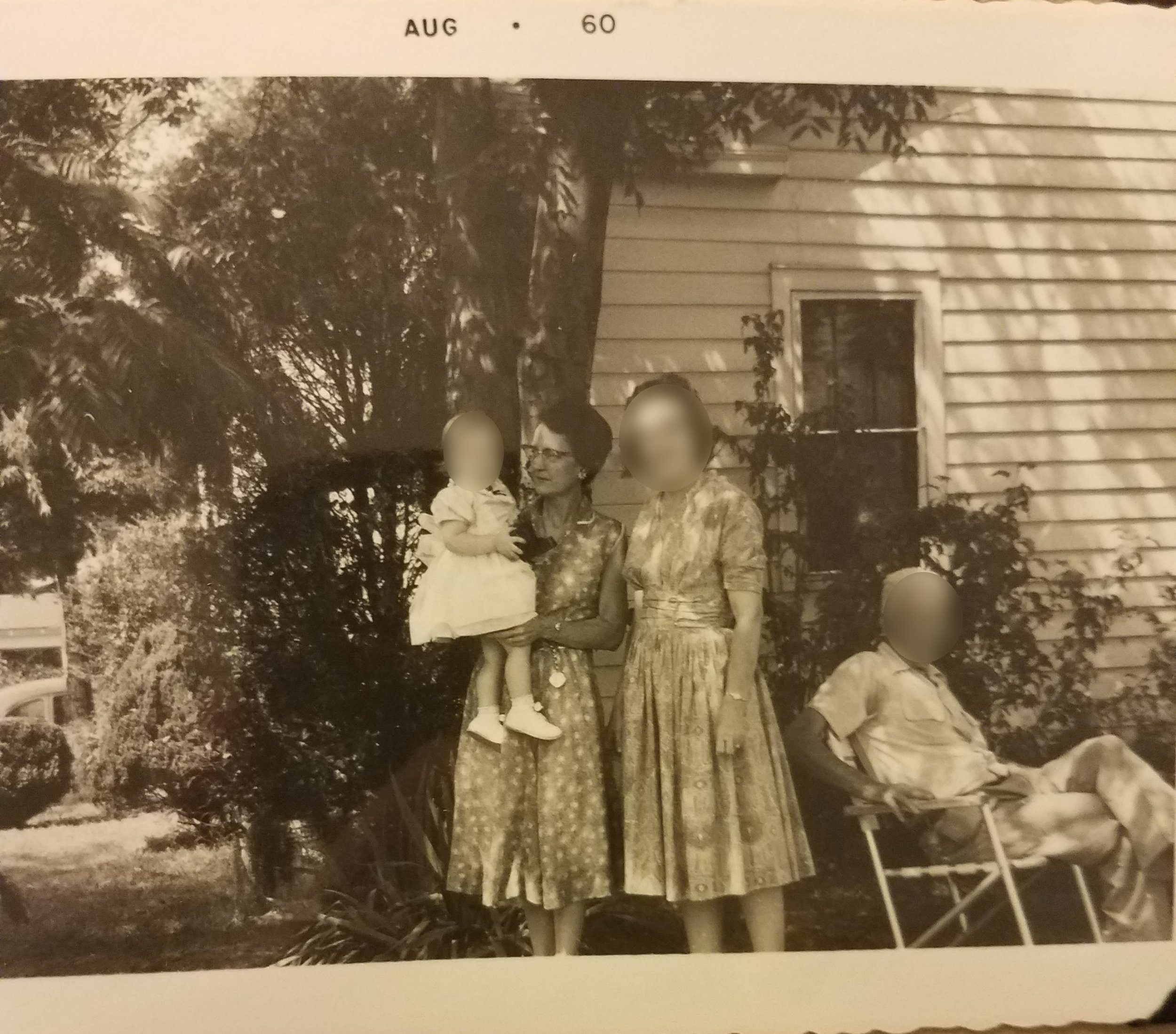 """The home in this photo was next door to the lot where Kathy was found. The woman holding the baby is Lena """"Margaret"""" McSpedden, who burned trash in a barrel 15 feet from Kathy's body just hours before she was found. Because the weeds in the lot were so high, McSpedden didn't notice Kathy.   For perspective, the vacant lot is behind the photographer. Grandview Avenue is to his or her left, and they alley is to his or her right.   Photo taken August 1960, shared courtesy of Julie Johnson"""