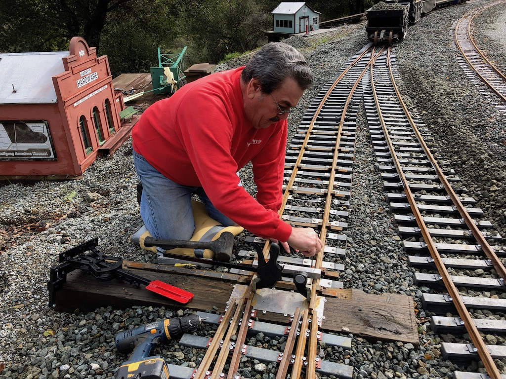 Carl working to solve track gauging issues on the stub switch