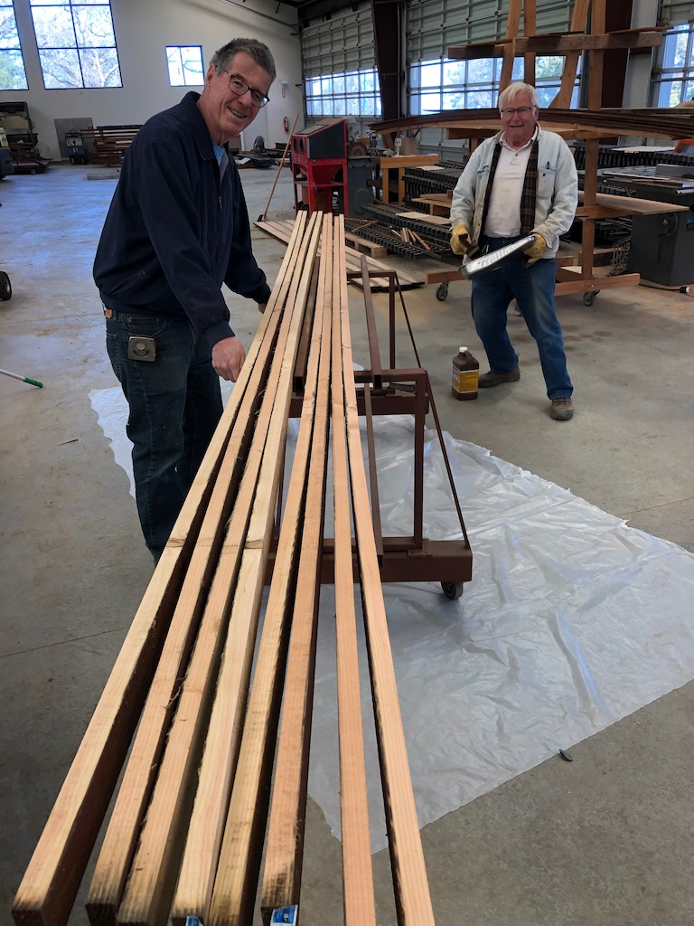 Mike and Paul preserve wood that will be used to protect the dam crossing by the new car barn