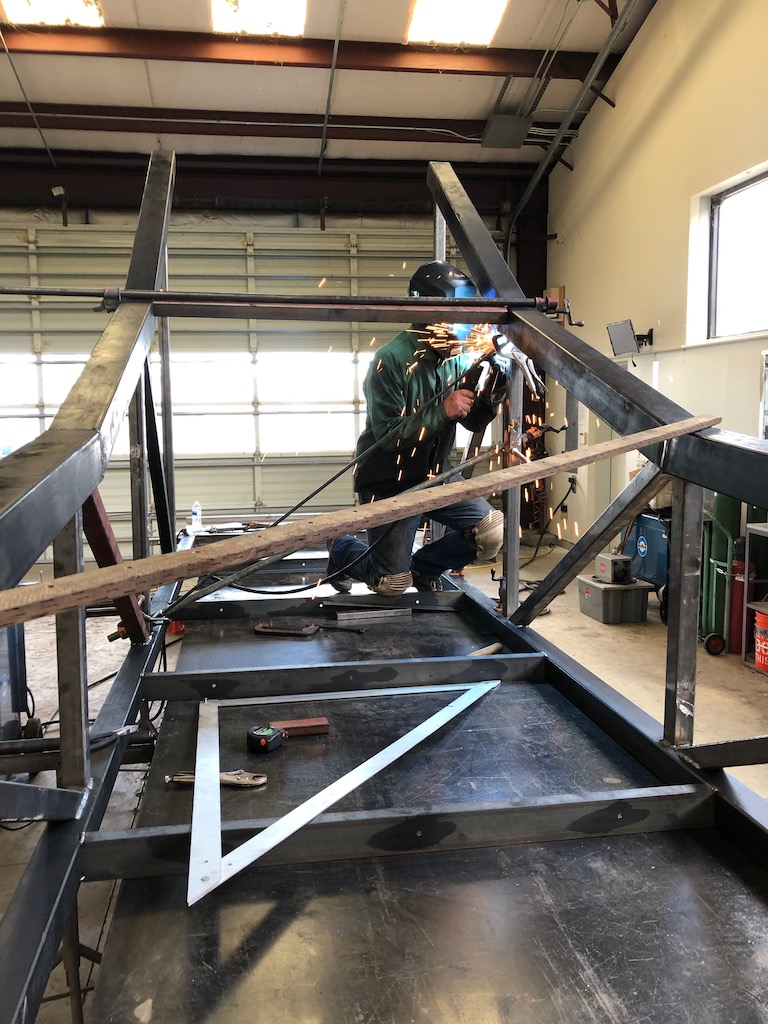 Tom, Bill, and Gerry making progress on 1/2 of the center arch