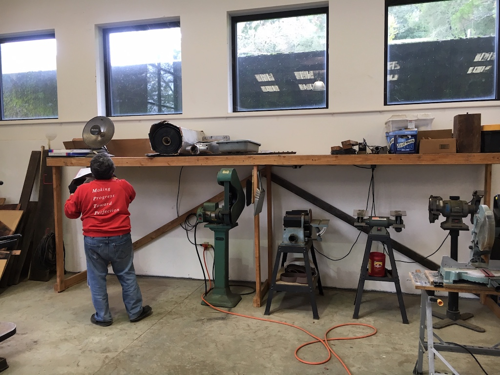 Carl arranges the abrasive equipment in the newly cleaned-up metalworking area
