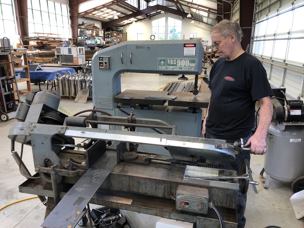 Tom gets back to cutting bridge parts